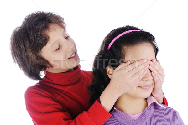 Stock photo: Girl covering a girls eyes to see if she can guess who is behind her
