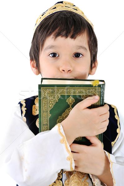 Muslim kid with holy Quran Stock photo © zurijeta