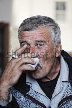 Yaşlı adam bıyık sigara içme sigara yüz Stok fotoğraf © zurijeta
