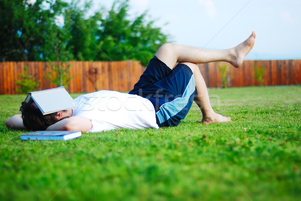 Young man is laying on green ground and sleeping Stock photo © zurijeta