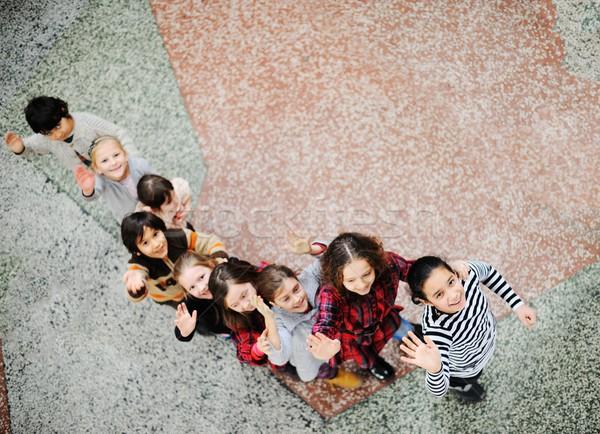 Cute lovely school children at clasroom having education activit Stock photo © zurijeta