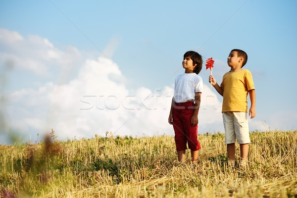 Little boy outdoors with a propeller toy in the summer against b Stock photo © zurijeta