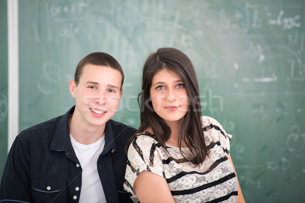 Sınıf arkadaşları oturma birlikte kız erkek sınıf Stok fotoğraf © zurijeta