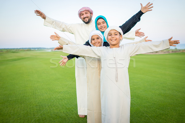 Arabic family on green meadow in nature Stock photo © zurijeta