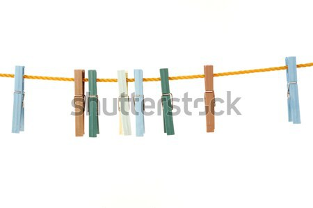 Laundry line with several clothespins on a sandy backround Stock photo © zurijeta