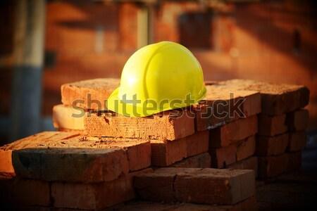 Under construction, helmet and bricks for building site Stock photo © zurijeta