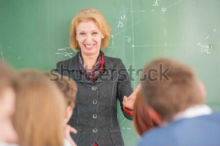 Boldog diák pózol fehér póló osztályterem Stock fotó © zurijeta