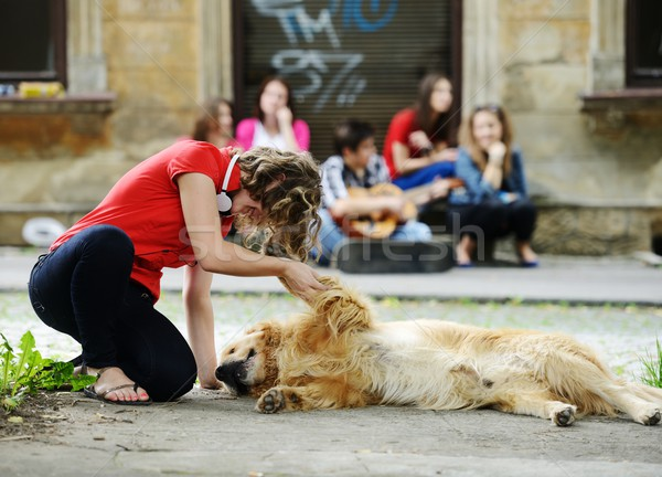 Young real people on the street with dog Stock photo © zurijeta