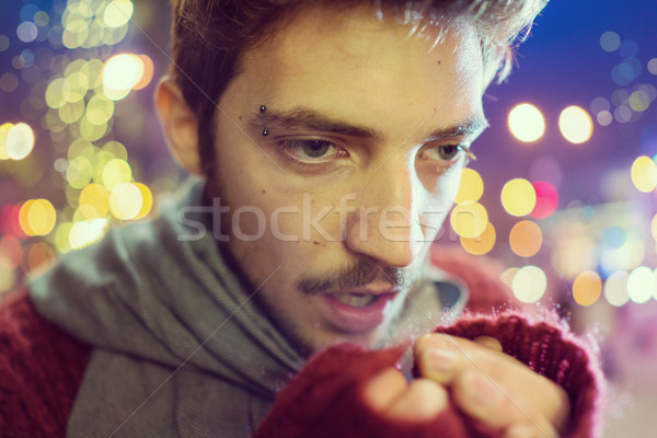Stock photo: Young people on the night city street freezing of cold