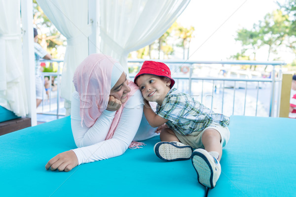 Happy Muslim young woman and little boy on summer vacation Stock photo © zurijeta