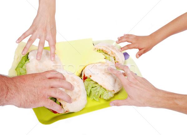 Quatro mãos sanduíche família comida Foto stock © zurijeta