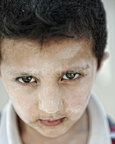 Portrait of poverty, little boy with strong look Stock photo © zurijeta