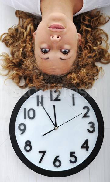 Menina relógio de cabeça para baixo feliz trabalhar tempo Foto stock © zurijeta