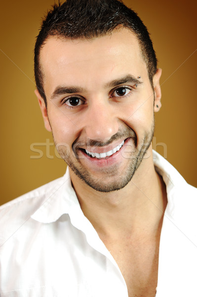 Portrait of a handsome young man on colored background with vignette  Stock photo © zurijeta
