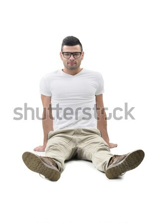 Férfi modell ül jóképű boldog izolált fehér Stock fotó © zurijeta