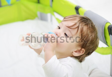 Stock photo: Adorable baby boy on home glass