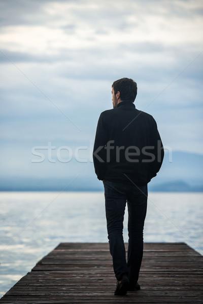 одиноко человека док ходьбе озеро воды Сток-фото © zurijeta