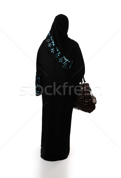 Muslim traditional woman with shopping bag, clothes from back, isolated Stock photo © zurijeta