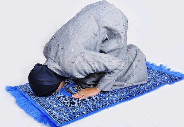 Young muslim woman praying on traditional way Stock photo © zurijeta