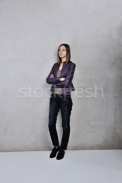 Pretty young woman standing daydreaming and romanticising her fantasies over grey background Stock photo © zurijeta