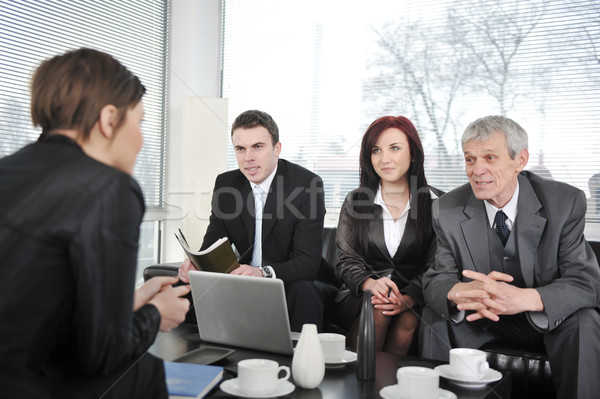 Businesswoman in an interview with three business people Stock photo © zurijeta