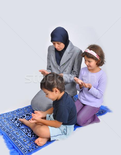 Muslim mother with children learning them Stock photo © zurijeta
