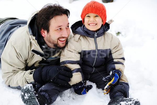 Baba oğul oynama mutlulukla kar kış sezonu gülümseme Stok fotoğraf © zurijeta