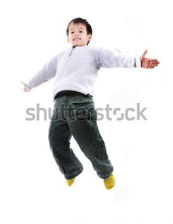 Adorable child jumping a over white background Stock photo © zurijeta