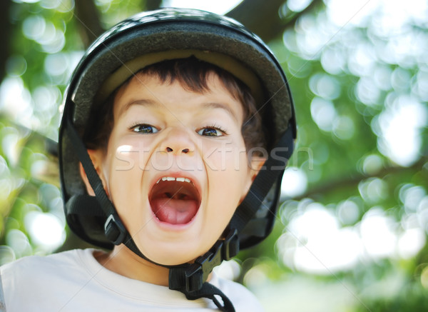 Little very cute kid with helmet on head and funny opened mouth Stock photo © zurijeta
