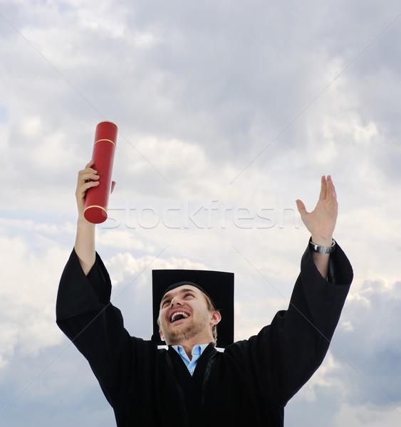 Jóvenes posgrado estudiante diploma aislado Foto stock © zurijeta