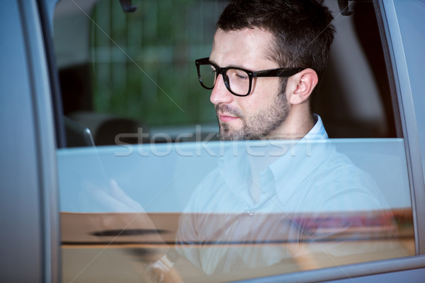 Sleek man with glasses in car Stock photo © zurijeta