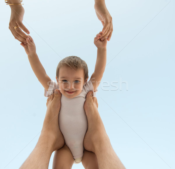 Parenting happy baby holding in air Stock photo © zurijeta
