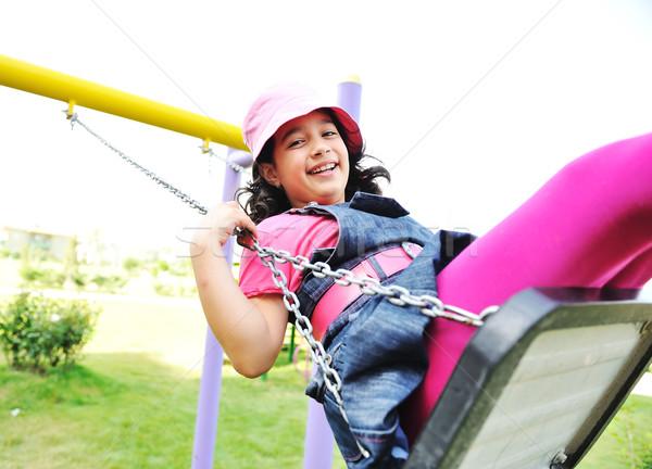On the playground, swinging Stock photo © zurijeta
