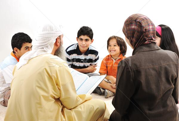 Education activity in Ramadan, Muslim couple and children reading Koran Stock photo © zurijeta