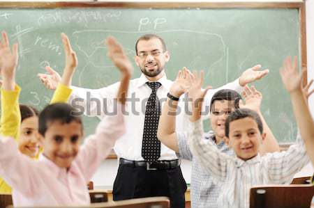Good teacher in classroom in front of the board Stock photo © zurijeta