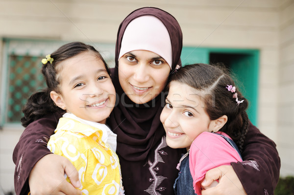 Muslim arabic mother with two daughters, love and care Stock photo © zurijeta