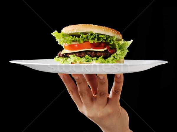 Hamburger main plaque alimentaire restaurant noir Photo stock © zurijeta