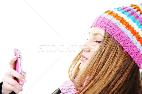 зима красивая девушка чтение sms сообщение сотового телефона Сток-фото © zurijeta