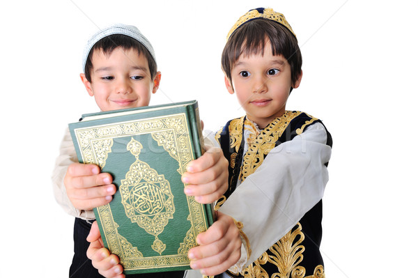 Two beautiful kids holding holy Quran Stock photo © zurijeta