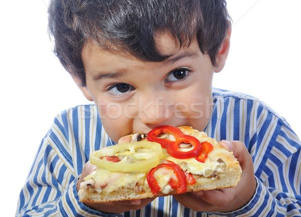 Bonitinho pequeno menino alimentação pizza isolado Foto stock © zurijeta