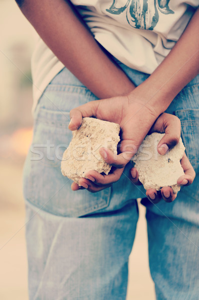 Palestinian Intifada boy with rocks in hands ready for fight Stock photo © zurijeta