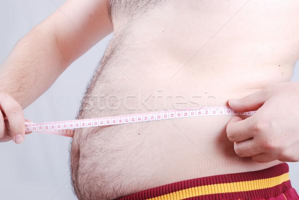 Grubas człowiek dżinsy biały facet brzuch Zdjęcia stock © zurijeta