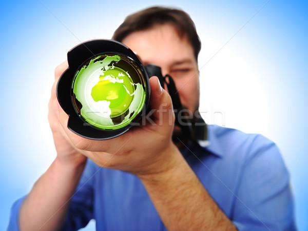 Adam kamera çekim toprak el dünya Stok fotoğraf © zurijeta