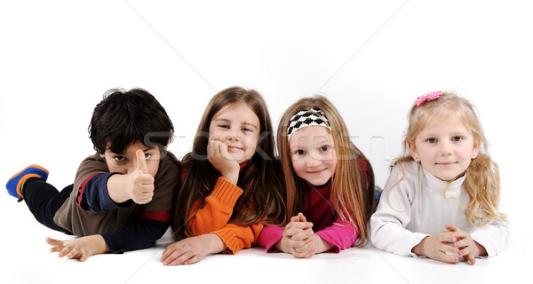 Children group family laying on ground floor isolated Stock photo © zurijeta