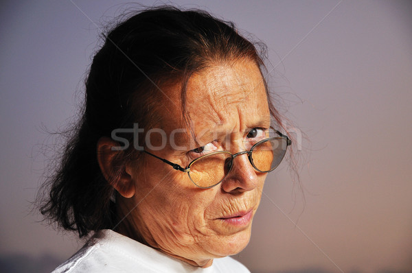 Angry face of elderly woman with nice background Stock photo © zurijeta