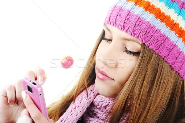 Winter Beautiful Girl reading sms message on cell phone Stock photo © zurijeta
