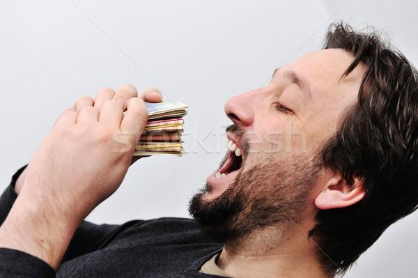 Man eating money Stock photo © zurijeta