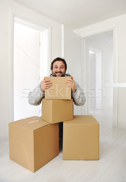 Man with boxes moving in new house Stock photo © zurijeta