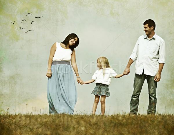 Retro image of happy family in nature having fun Stock photo © zurijeta