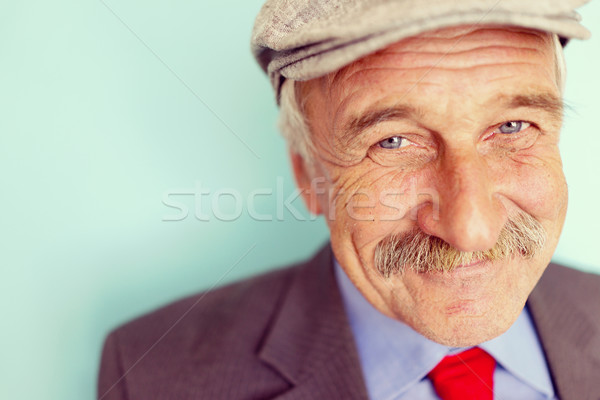 Portrait of a smiling and confident mature businessman with must Stock photo © zurijeta